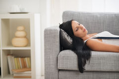 Young woman sleeping on sofa Stock Images