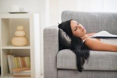 Young woman sleeping on sofa Stock Images