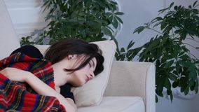 Young woman sleeping on the sofa at home Royalty Free Stock Photography