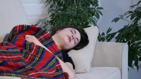 Young woman sleeping on the sofa at home Royalty Free Stock Photos