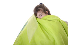Young woman sleeping under a bedspread Royalty Free Stock Images