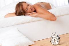Young woman sleeping on white bed Royalty Free Stock Photos