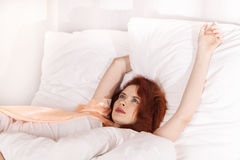Young woman sleeping on the white bed-clothes in bed at home Stock Images