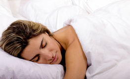 Young woman sleeping on white bed sheet Stock Image