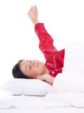 Young woman sleeping in white bedding Stock Images