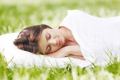 Woman sleeping on grass Stock Photography