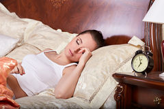 Young woman sleeps in bed in the bedroom. royalty free stock photos