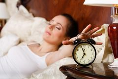 Young woman sleeps in bed in the bedroom. Stock Image