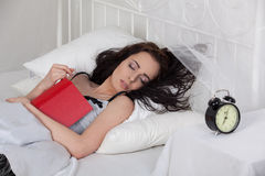 Young woman sleeps in bed at home. Royalty Free Stock Photos