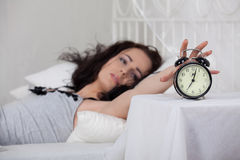 Young woman sleeps in bed at home. Royalty Free Stock Images