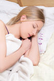 Young woman sleeps in bedroom at home Stock Images