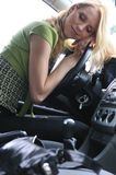 Young woman sleeps in car Royalty Free Stock Images