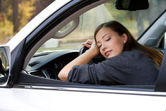 Young  woman sleeps in the car Stock Photo
