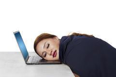 Young woman sleeps on laptop Stock Image
