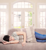 Young woman sleeps on the sofa Stock Photography