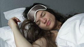 Young woman sleeps ugly after drinking alcohol. Hangover Syndrome.