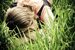 Young Woman Slept On The Grass Stock Images