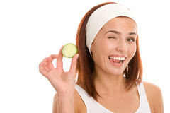 Woman with slice of cucumber Royalty Free Stock Photo
