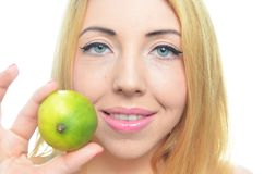 Young woman with sliced lime Stock Photography