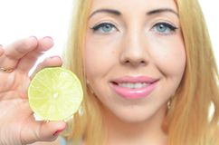 Young woman with sliced lime Royalty Free Stock Images