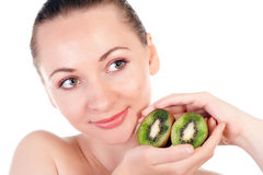 Young woman with slices of kiwi Stock Photos