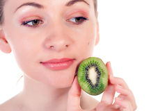 Young woman with slices of kiwi Stock Photo