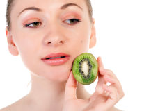 Young woman with slices of kiwi Royalty Free Stock Photo