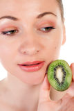 Young woman with slices of kiwi royalty free stock image