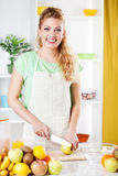 Young woman slicing apple Stock Photography