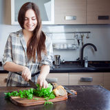 Young woman slicing a salad for your family Royalty Free Stock Images