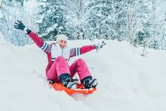 Free Young Woman Slide Down From Snow Slope Sitting In One Slide.Winter Activities Concept Image Stock Photos - 136724093