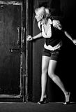 Young woman slinking to the door Stock Photos