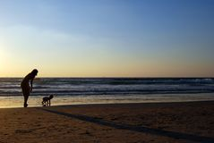 Young woman with small child. On the sea shore on sunset stock photography