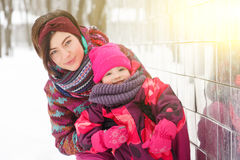 Young woman with small daughter Stock Photos