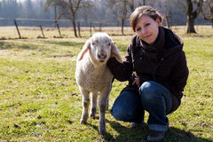 Young woman with small lamb look happy Stock Images