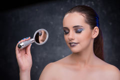 The young woman with small mirror in beauty concept Royalty Free Stock Photography