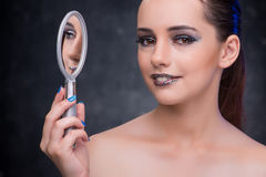 The young woman with small mirror in beauty concept Royalty Free Stock Image