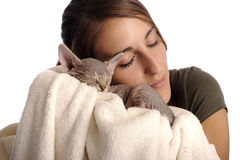 Young woman with small sphinx cat Stock Images
