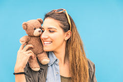 Young woman and small vintage teddy bear Royalty Free Stock Images