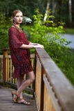 Young woman on small wooden bridge Royalty Free Stock Images