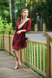 Young woman on small wooden bridge Stock Images