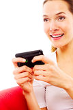 Young woman with smart phone Stock Photography