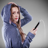 Young woman with smart phone listening music Royalty Free Stock Photos