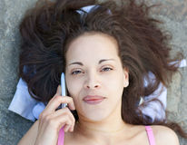 Young woman and smartphone Royalty Free Stock Photo