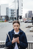 Young woman With Smartphone In City Royalty Free Stock Photography