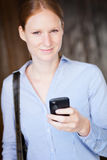 Young Woman with a Smartphone Royalty Free Stock Photos
