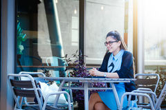 Young woman with smartphone in coffee shop Stock Photo