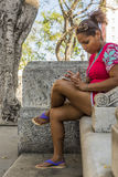 Young woman with smartphone Havana royalty free stock photos