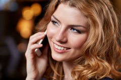 Young woman with smartphone at night club or bar Royalty Free Stock Photos