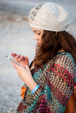 Young woman with smartphone Stock Photography